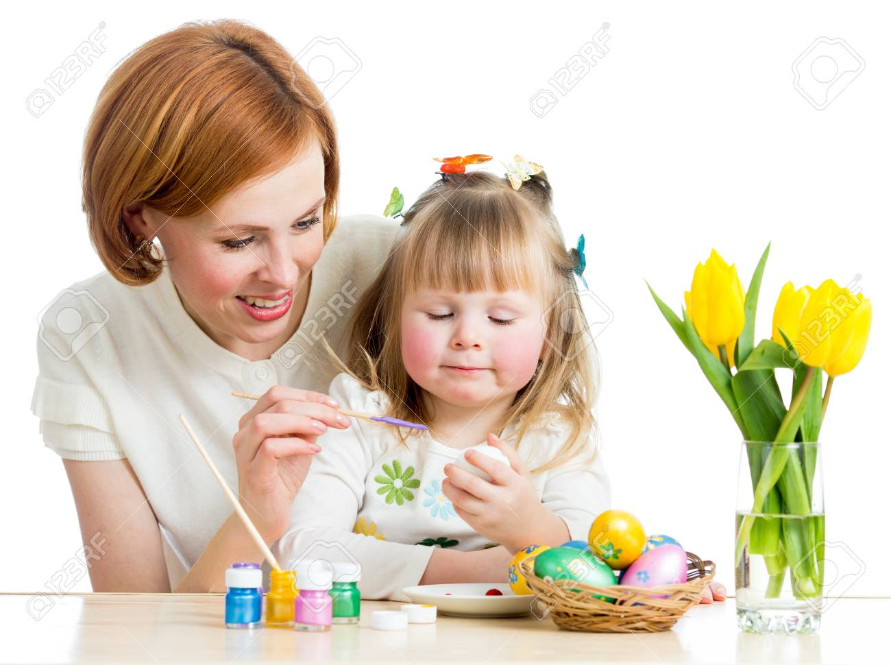 mother and baby kid painting easter eggs isolated Stock Photo - 17927418