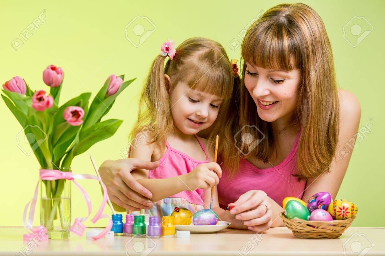 mother and daughter child painting easter eggs Stock Photo - 18029298