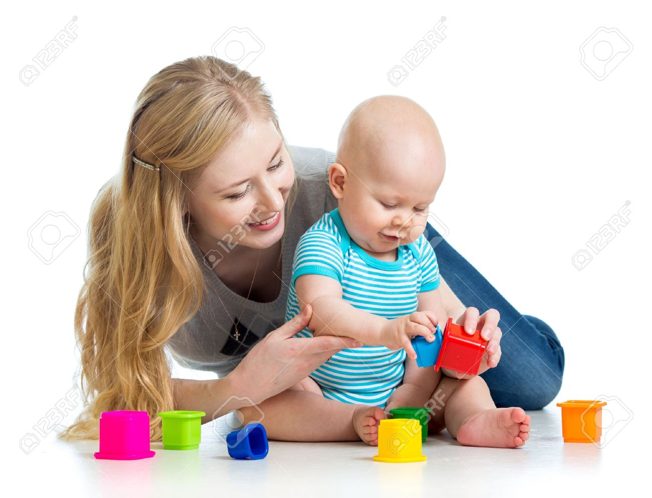 kid boy and mother playing together with cup toys Stock Photo - 18202172
