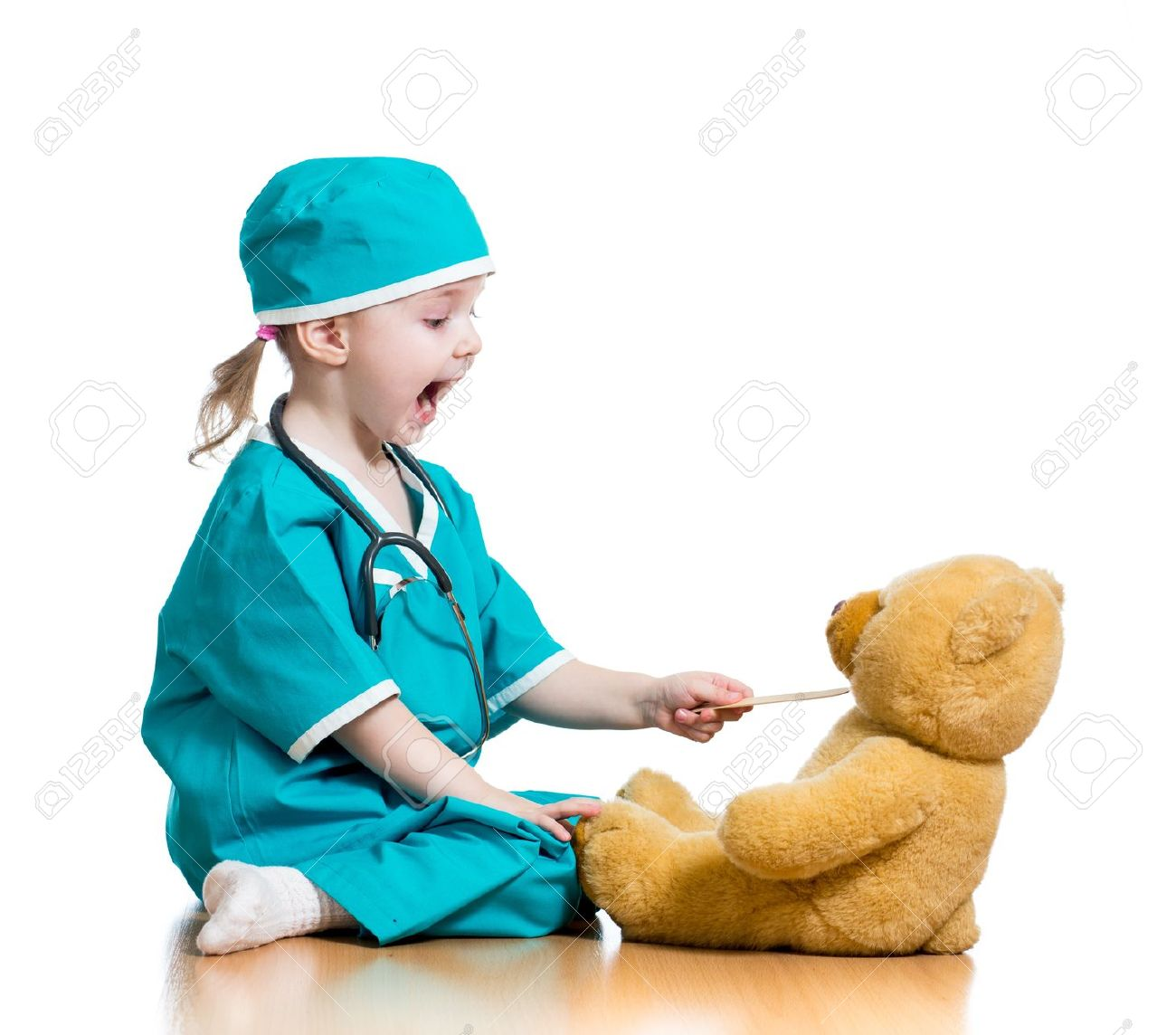 doctor kid Adorable child dressed as doctor playing with toy over white Stock Photo -  18231015