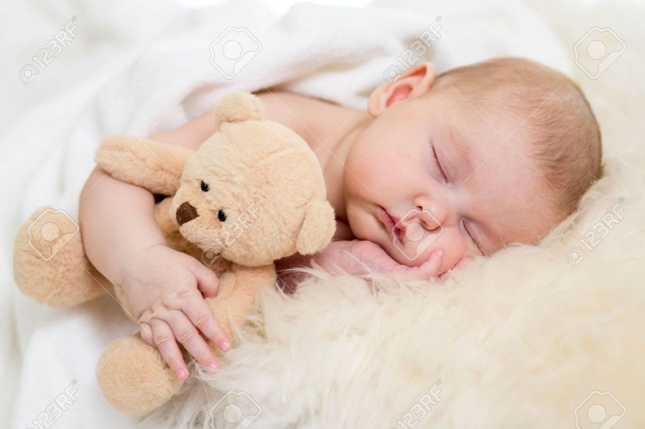 Baby bed newborn - Stock Photo Newborn Baby Sleeping On Fur Bed