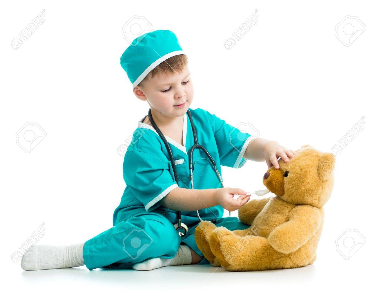 doctor kid Stock Photo - boy kid playing doctor with toy