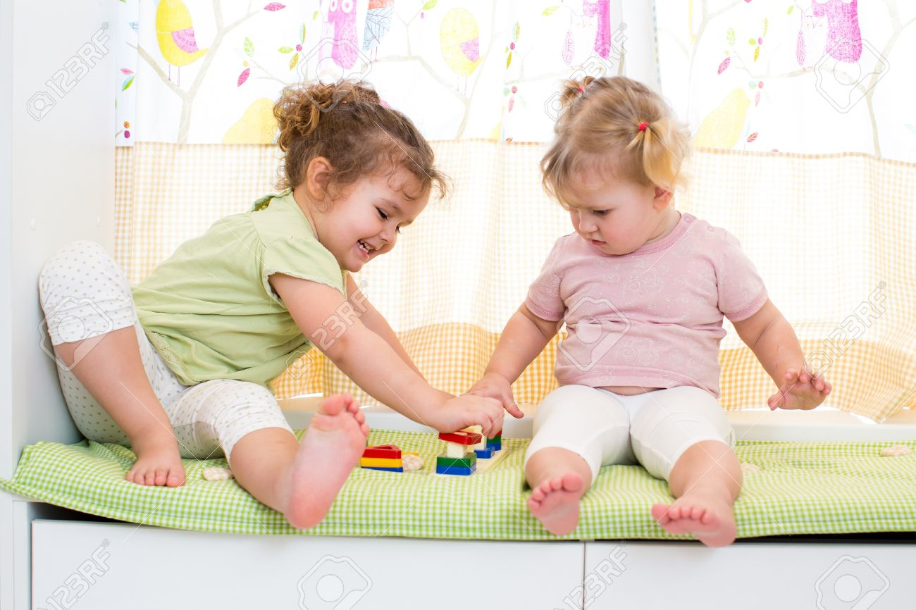 children sisters play together indoors Stock Photo - 19202653