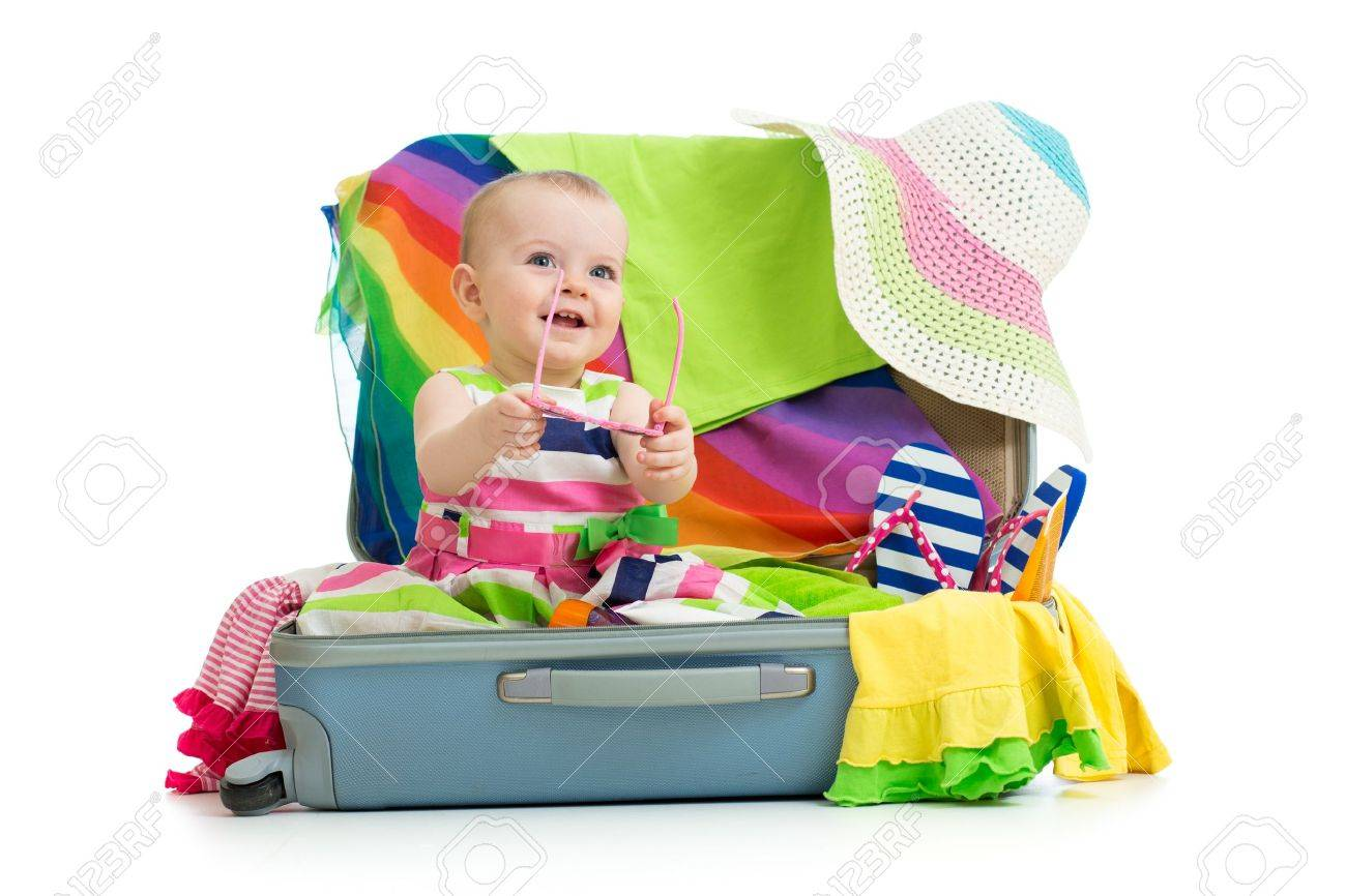 Baby girl sitting in suitcase with  things for vacation travel Stock Photo - 19668408