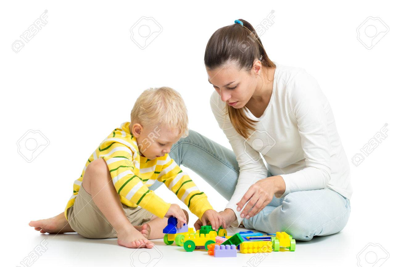 kid boy and mother play together with construction set toy Stock Photo - 22484902