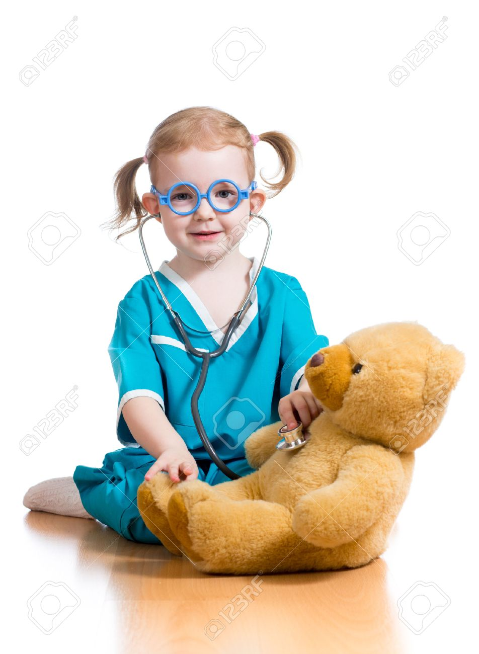doctor kid Stock Photo - kid playing doctor with toy