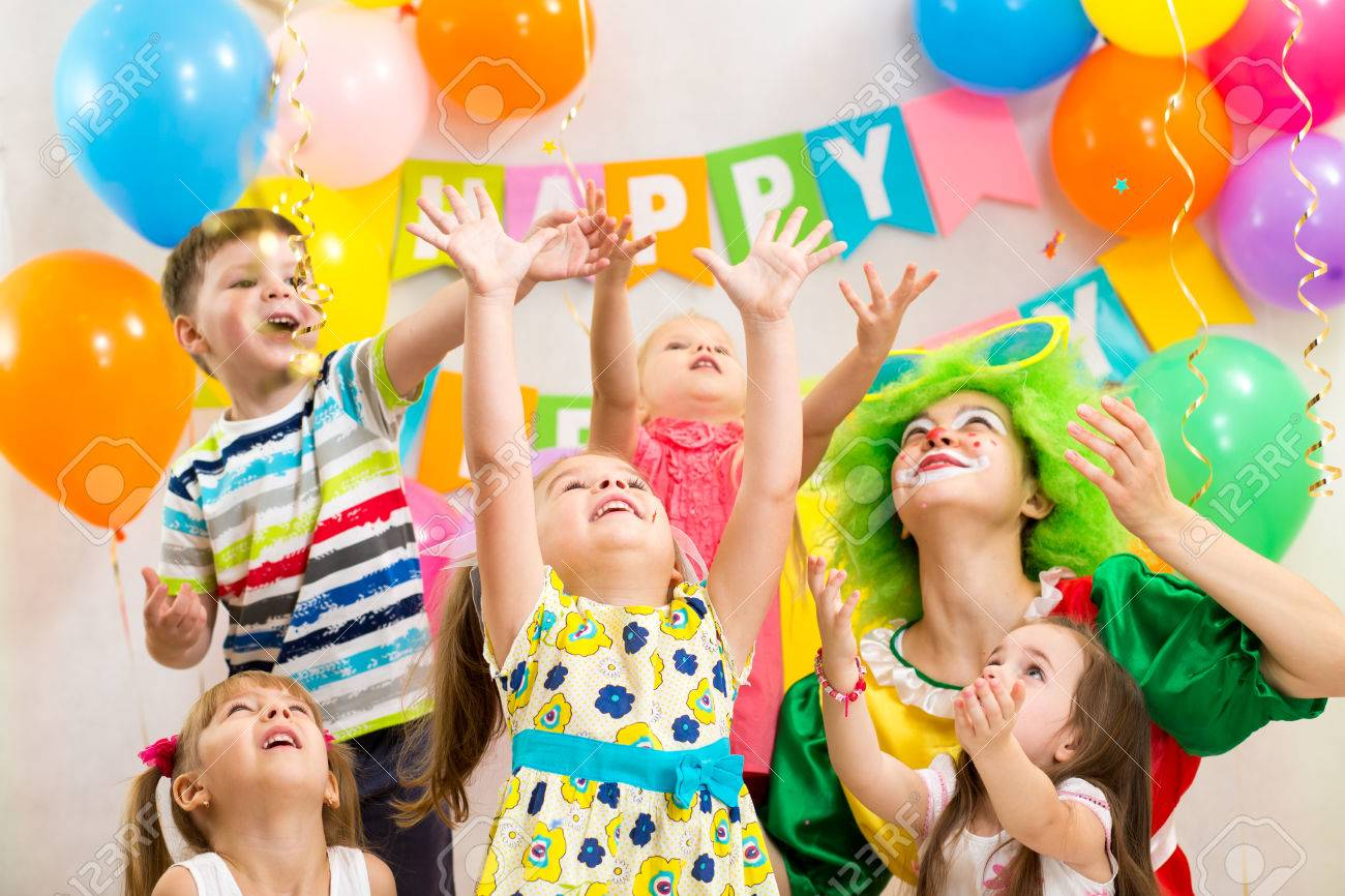 jolly kids group with clown celebrating  birthday party Stock Photo - 23108681