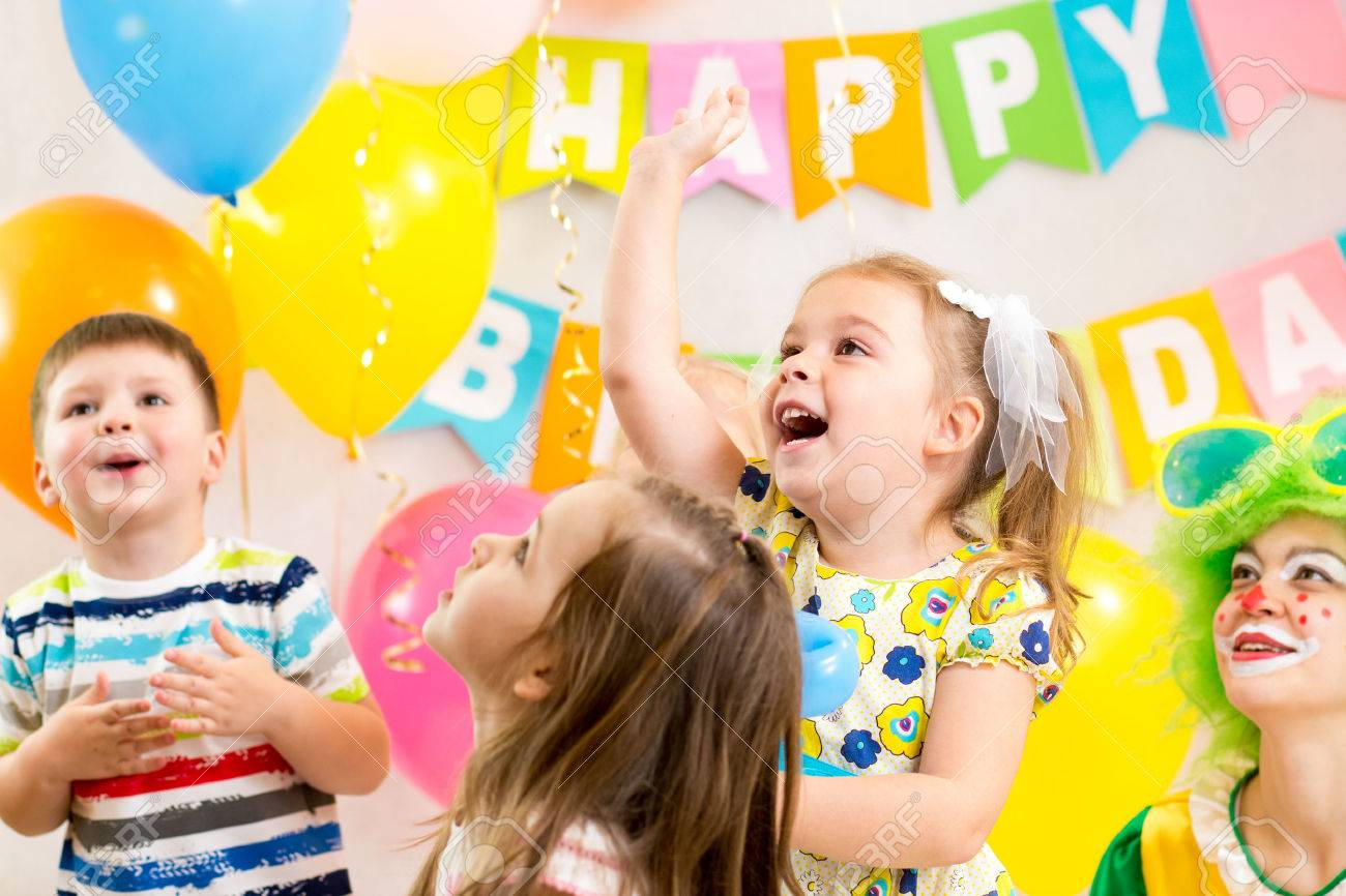 jolly kids group with clown celebrating  birthday party Stock Photo - 23177065