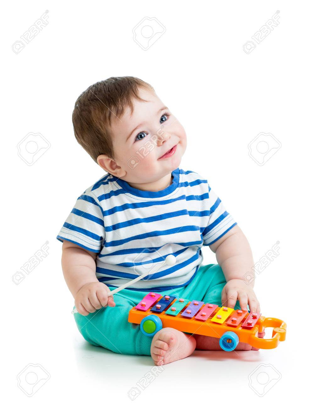 Nice baby playing with musical toys stock photo 25298402