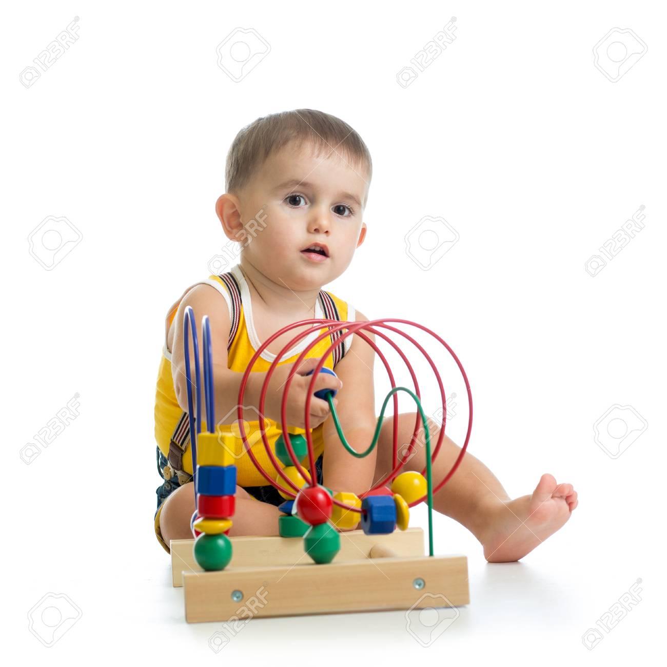Pretty boy using toy