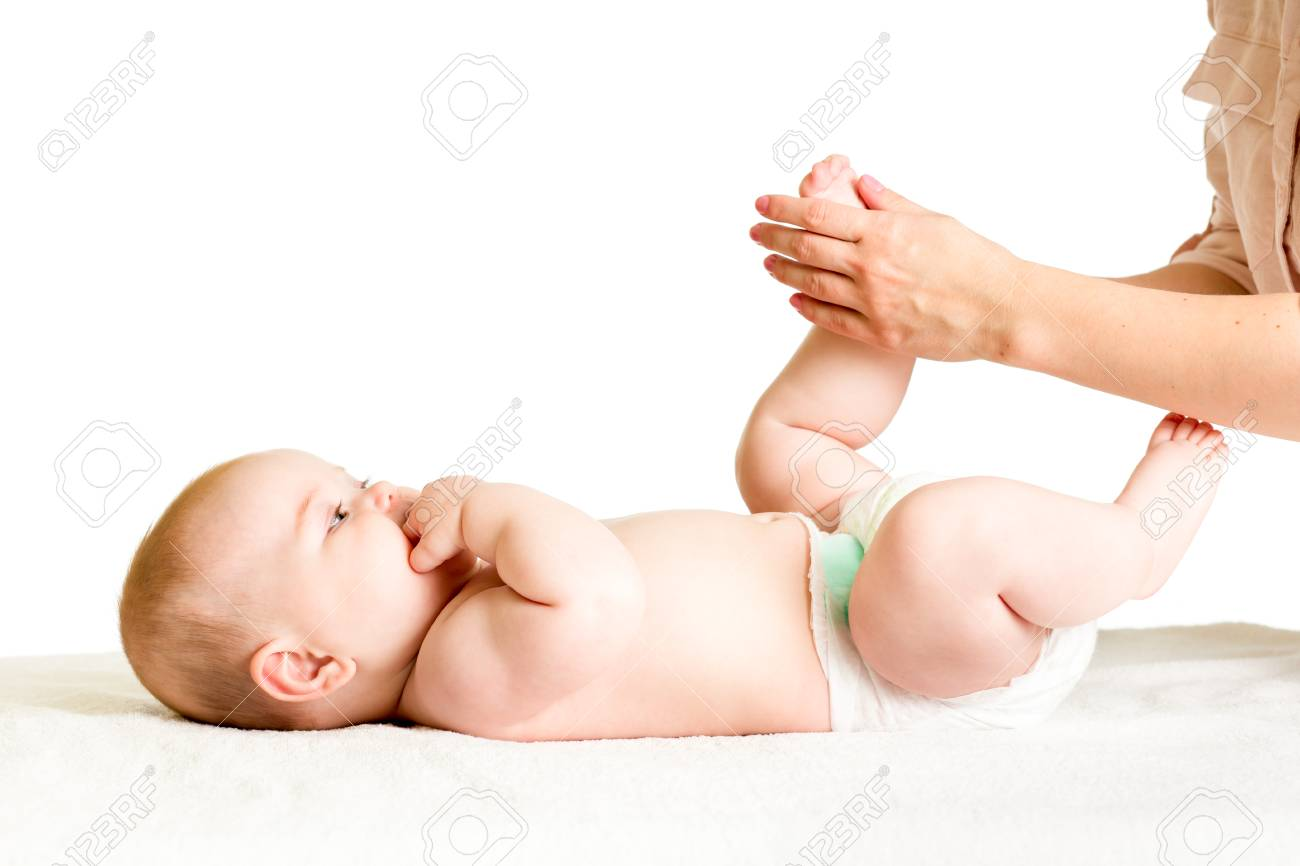 7223c963d Doctor Massaging Or Doing Gymnastics Baby Girl Stock Photo