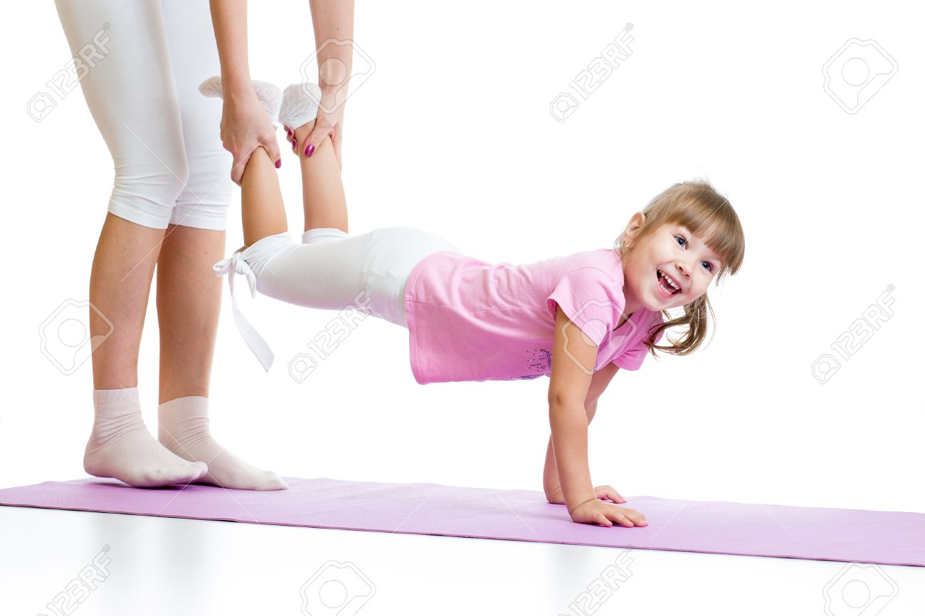 gymnastic kids kid girl doing gymnastic and standing on her hands isolated Stock Photo -  33122611
