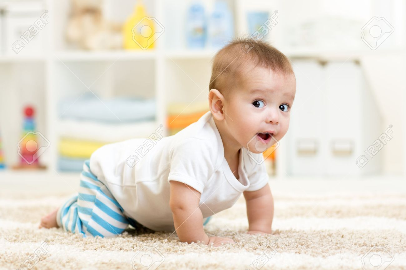 crawling funny baby boy indoors at home Stock Photo - 34592008