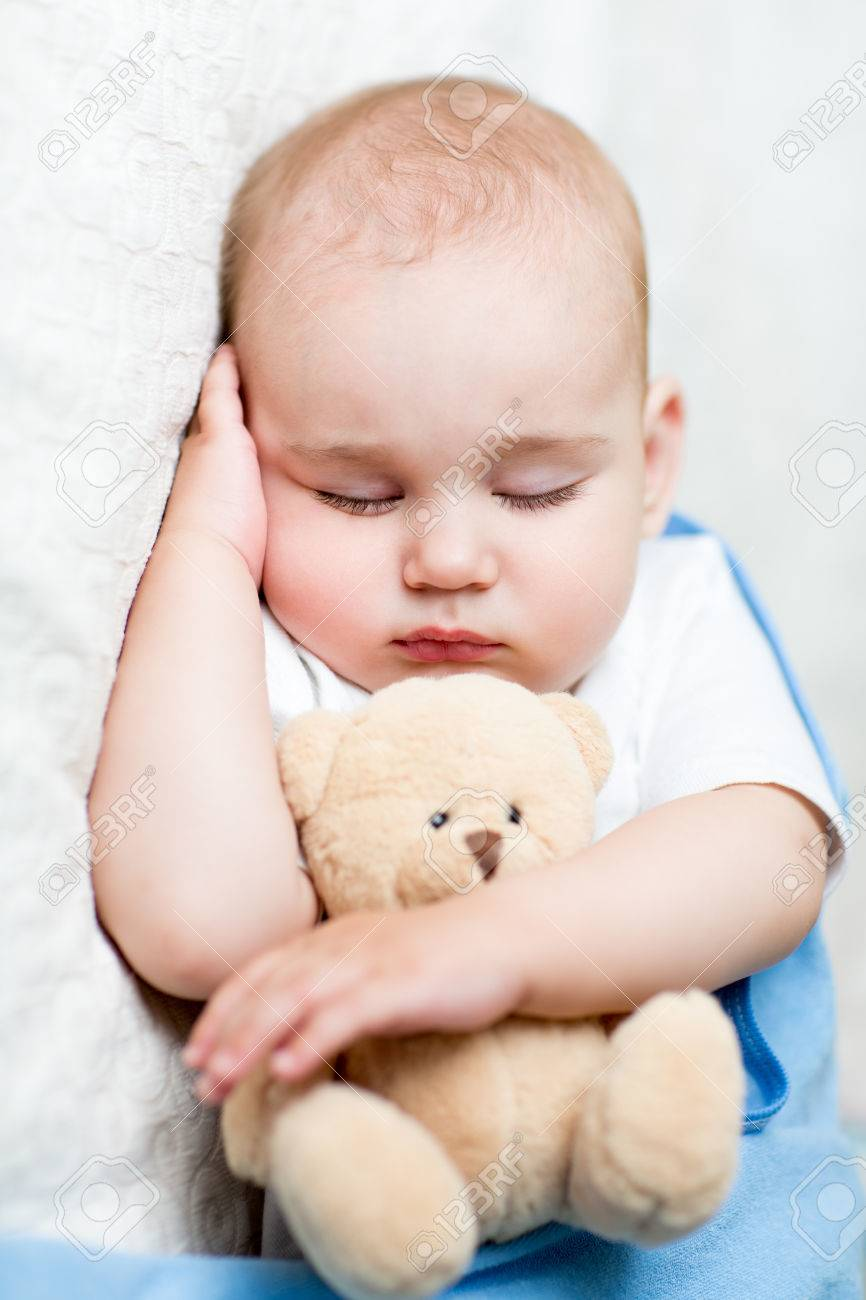 Cute Sleeping Baby Boy With Teddy Bear Stock Photo Picture And Royalty Free Image Image 44258255