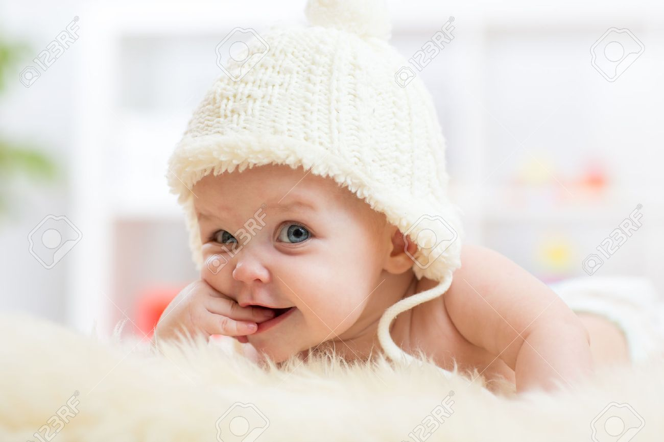792c40078e0 Cute little baby girl looking into the camera and weared in white hat. Stock  Photo