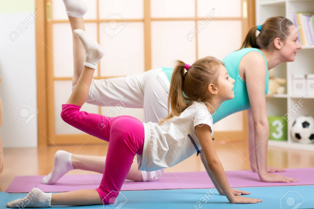 Pregnant woman with her first child doing fitness in living room Stock Photo - 48966958