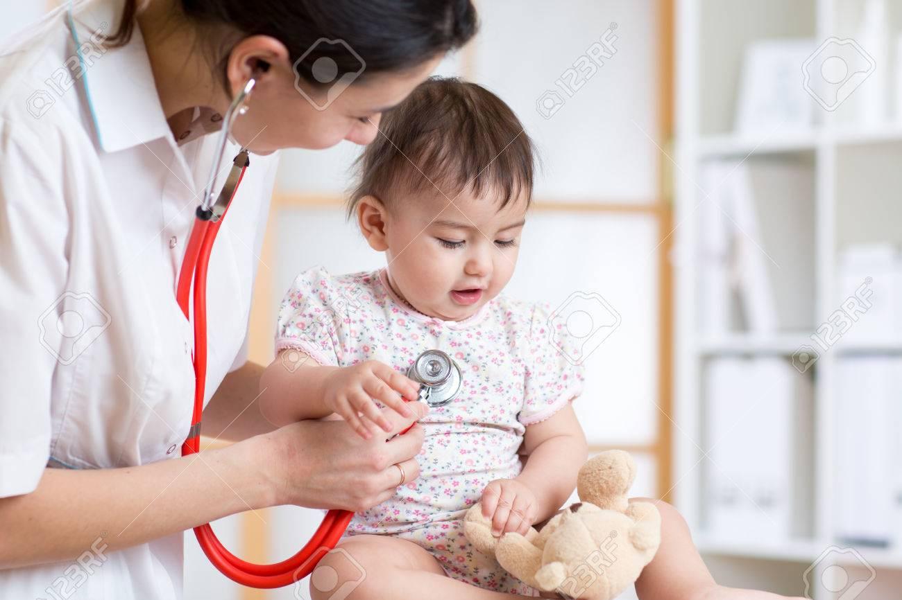 pediatrician woman examining of baby kid in office Stock Photo - 52416156