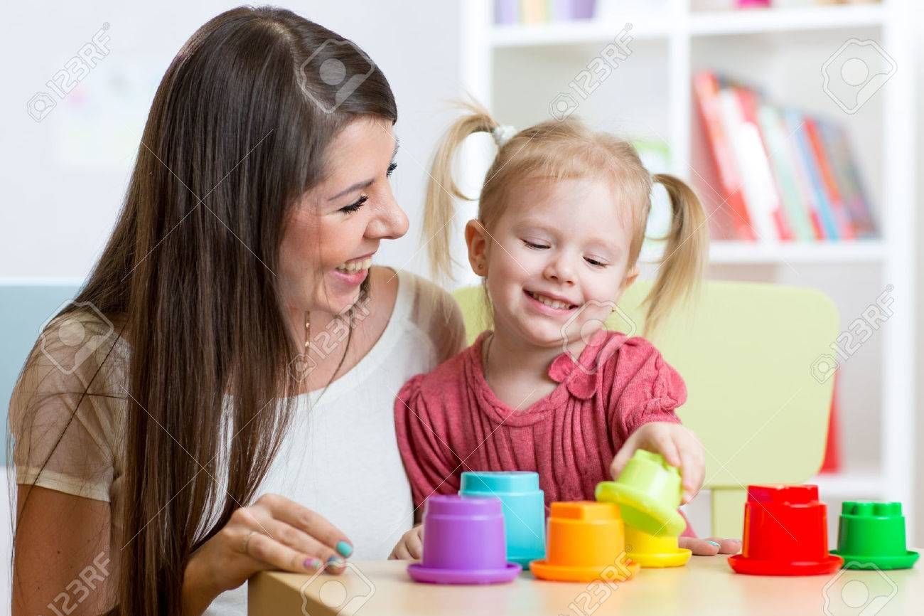 cute mother and her child play toys indoors Stock Photo - 54307257
