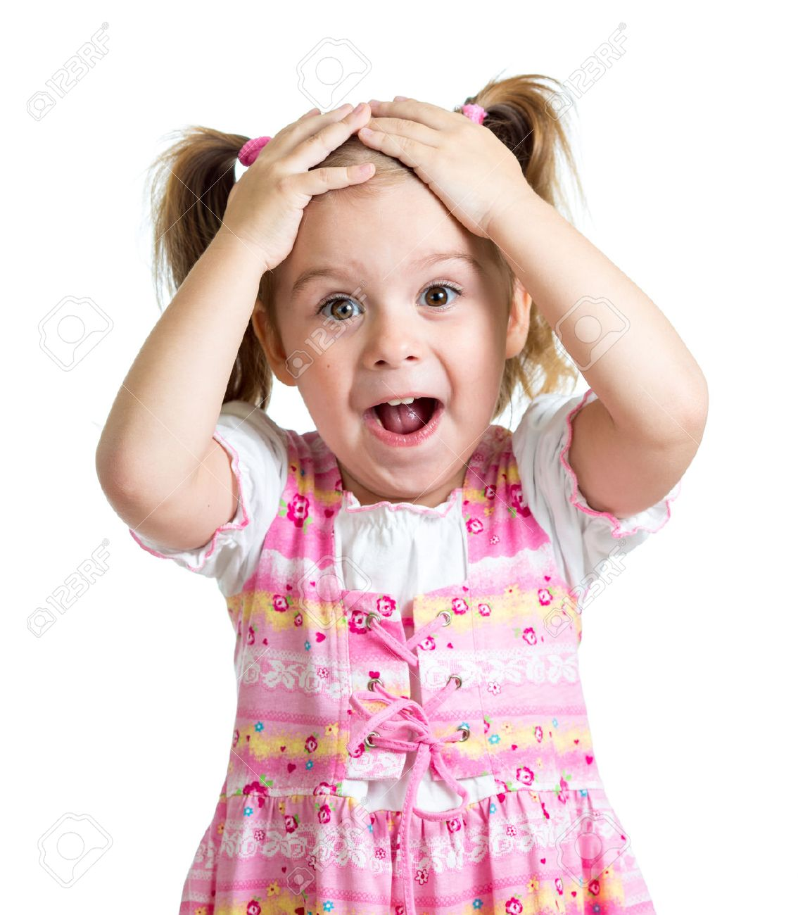 Amazed or surprised child kid hands holding head isolated Stock Photo - 54307443
