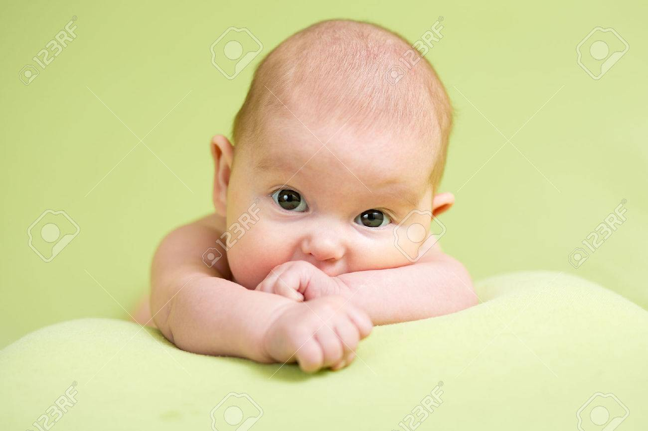 Baby newborn infant kid lying on belly Stock Photo - 58616990