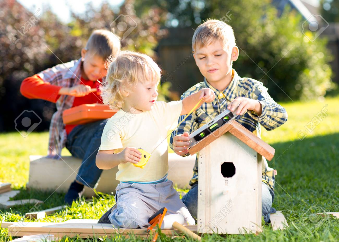 Fine Three Little Boys Brothers Building Birdhouse Outdoors Download Free Architecture Designs Scobabritishbridgeorg