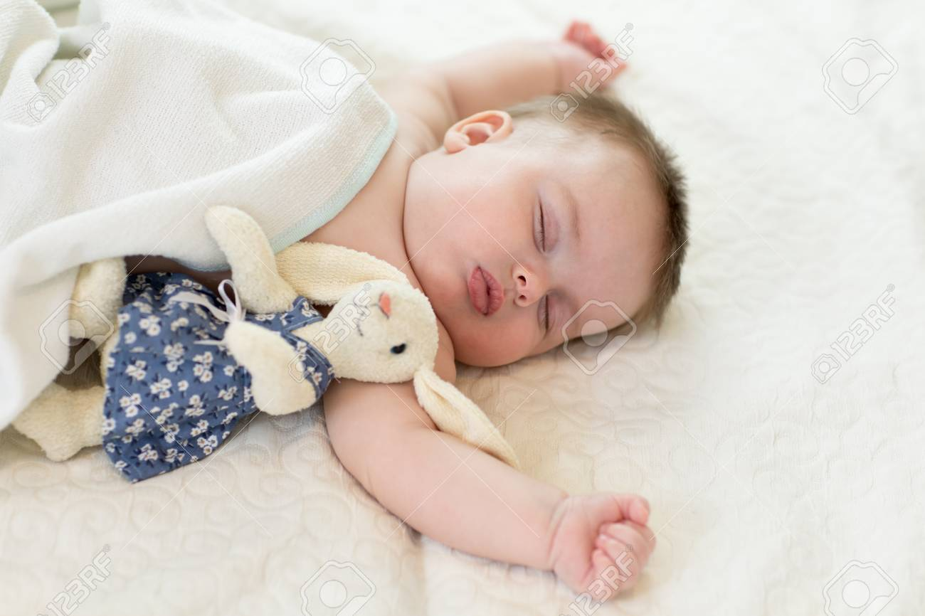 Sweet Baby Sleeping Under Blanket At Home Stock Photo Picture And Royalty Free Image Image 94264723