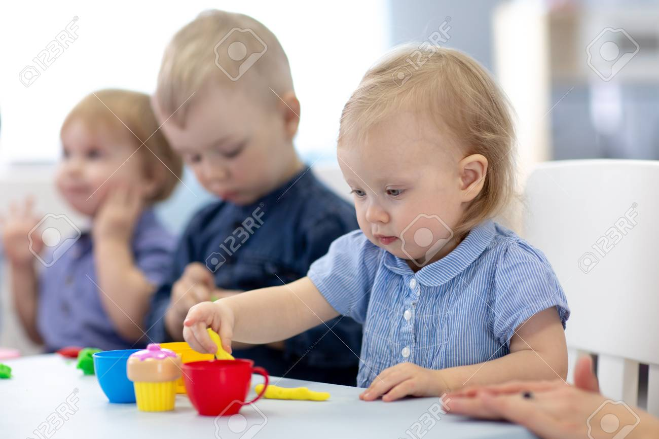 Group of babies kids engaged in handcrafts - 122596895