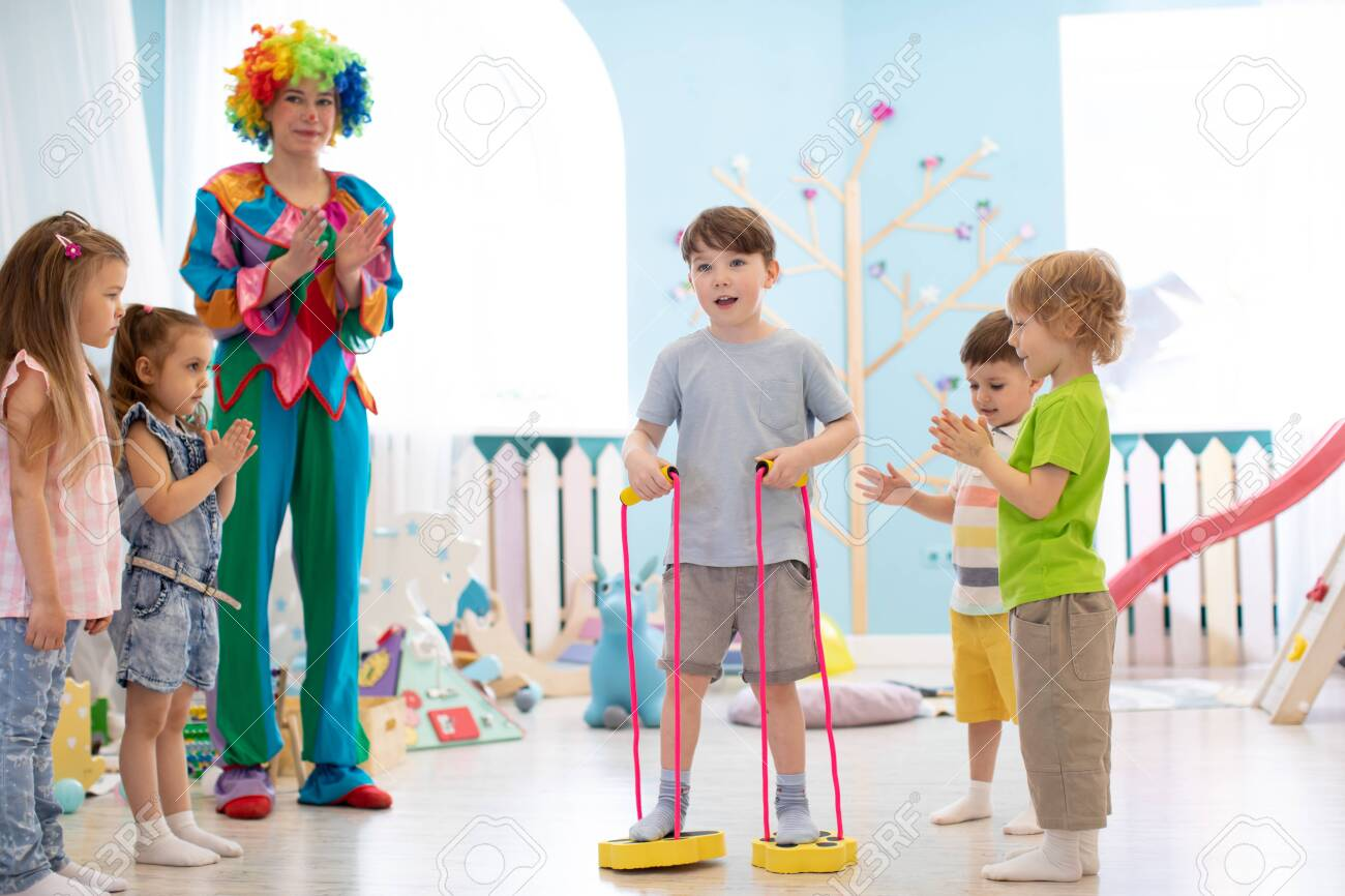 happy children and clown on birthday party - 124452615