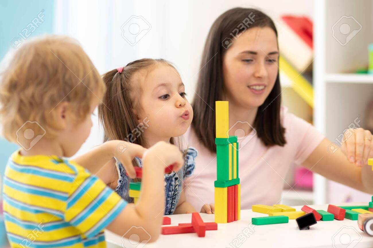 Kids with teacher in kindergarten - 135024812