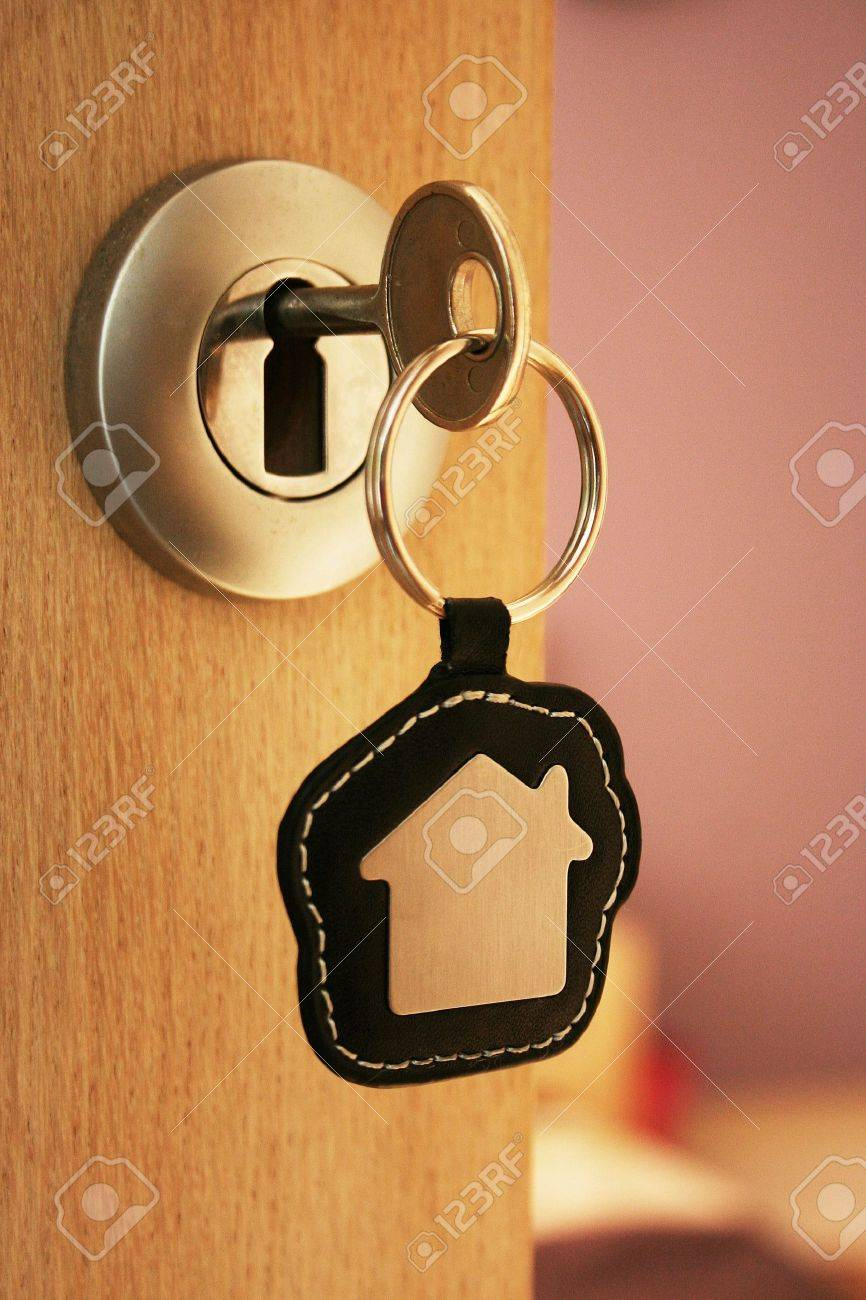 A key in a lock with house icon on it Stock Photo - 7934160