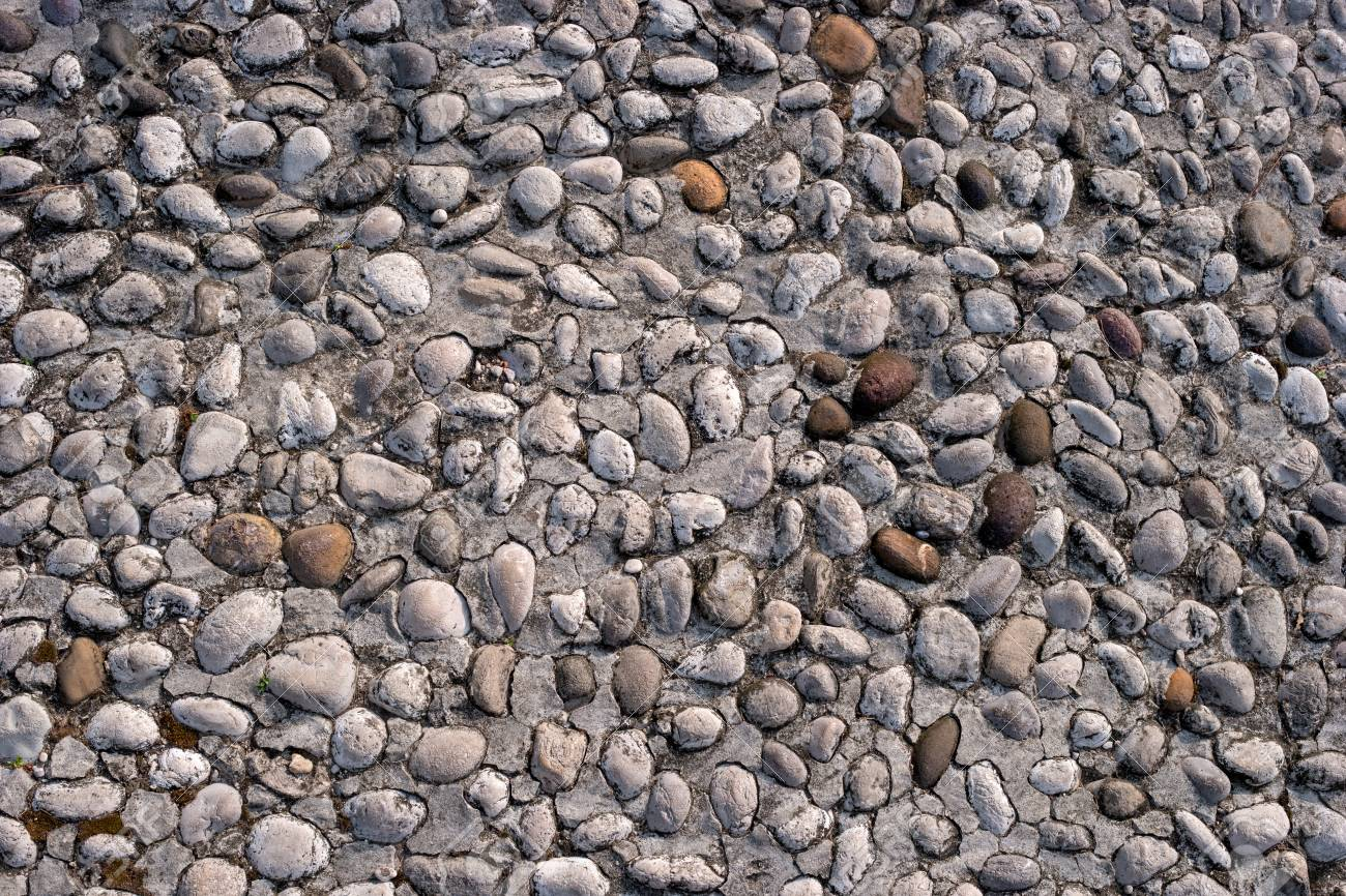 . Road from small cobblestone for stone texture or seamless background