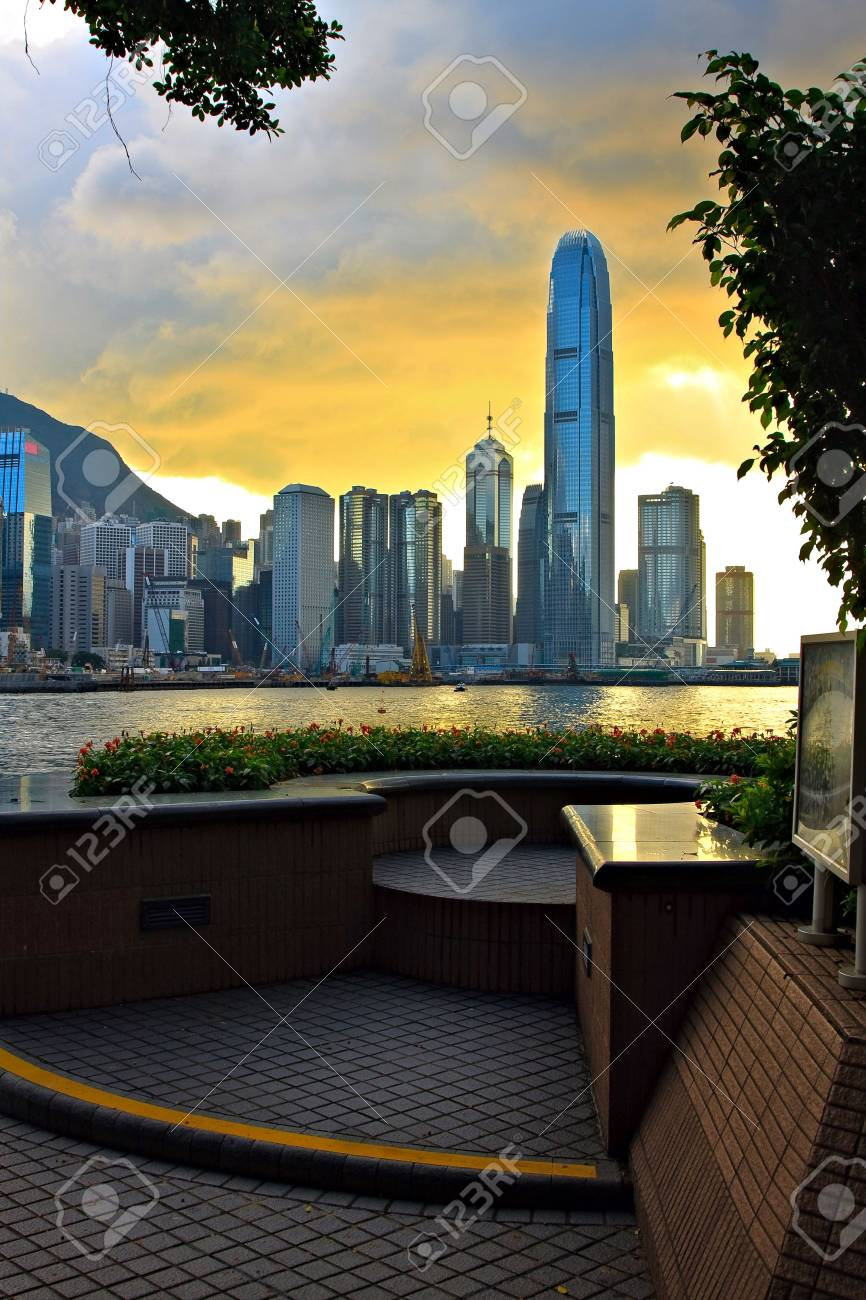 Hong Kong Sunset Skyline With Trees Silhouette And Flowerbed Stock Photo Picture And Royalty Free Image Image 5830950