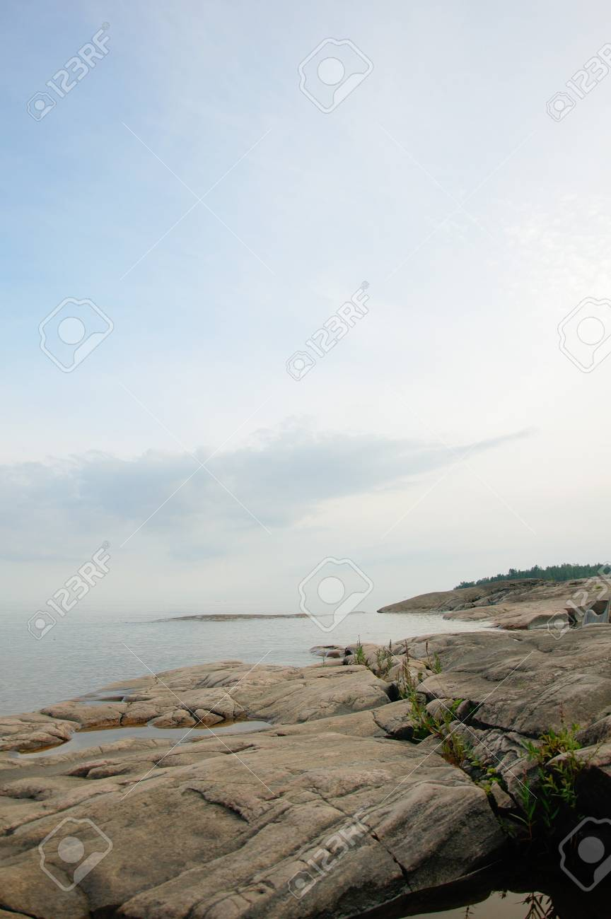 Lake viewed from the rocky coastline close to Karlstad, Sweden Stock Photo - 8139747