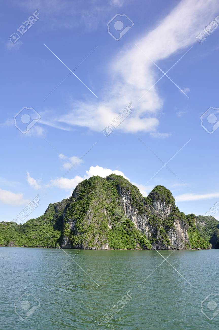 Sea, sky and an island viewed from Halong Bay, Vietnam Stock Photo - 8208069