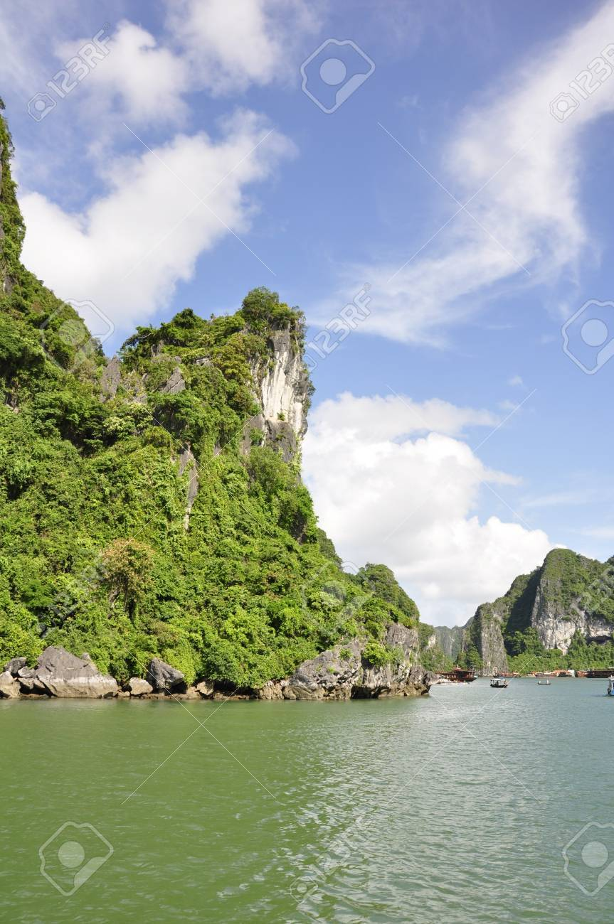 Sea, sky and island mountain side viewed from Halong Bay, Vietnam Stock Photo - 8208070