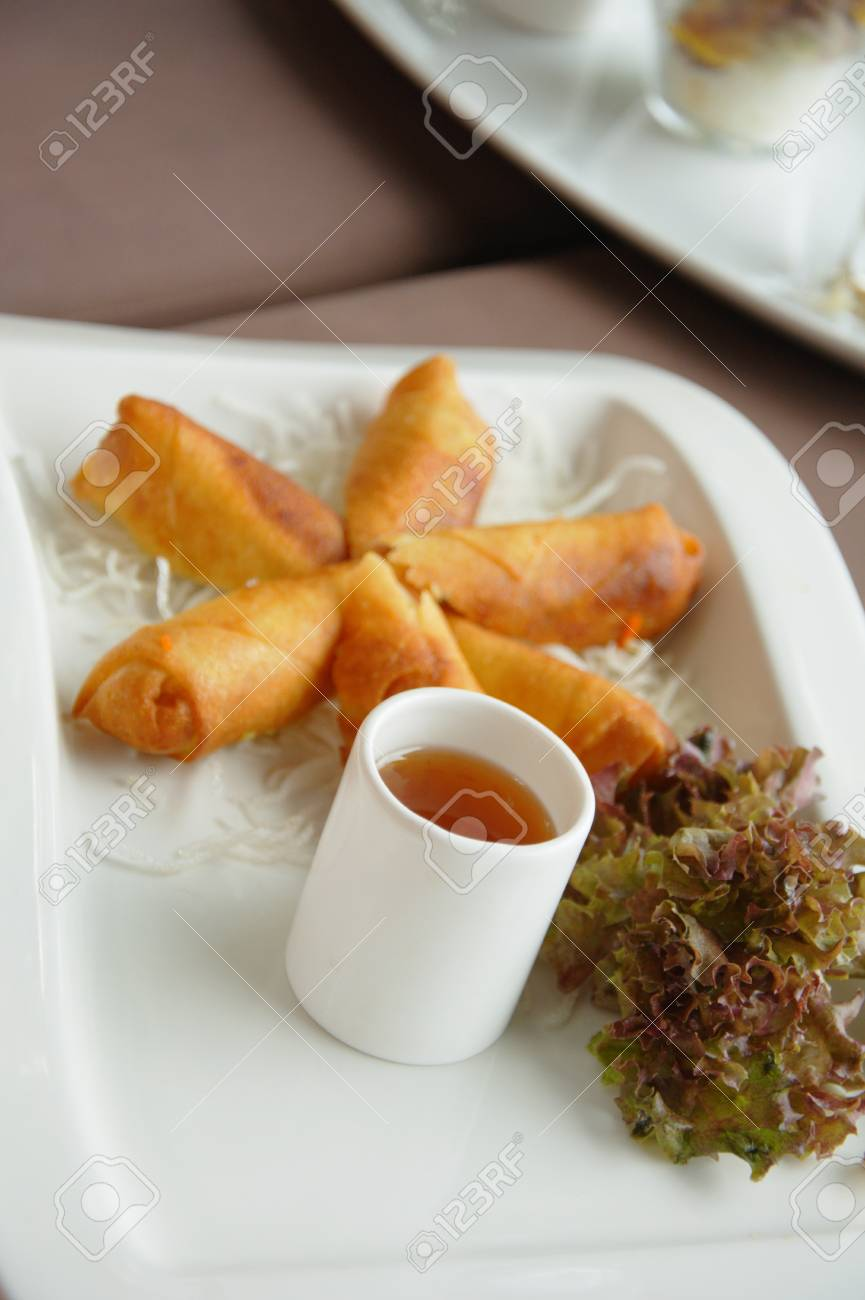 Spring rolls on a plate with salad and sweet chili Stock Photo - 10035578