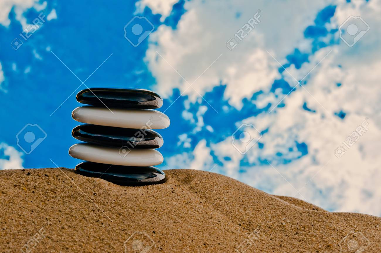 Black and white polished stones on a beach Stock Photo - 10360292