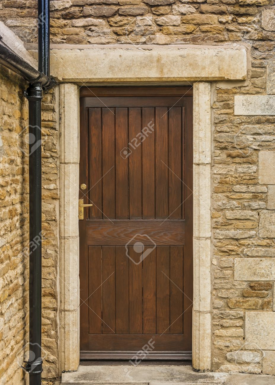 Brown Wooden Slatted Door With Lock And Lever Handle Stock Photo ...