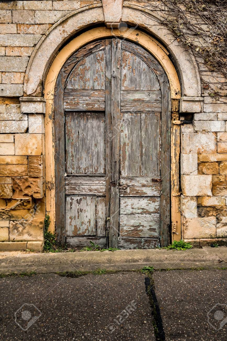 Old decaying wooden double doors in a stone archway Stock Photo - 43115076 & Old Decaying Wooden Double Doors In A Stone Archway Stock Photo ...