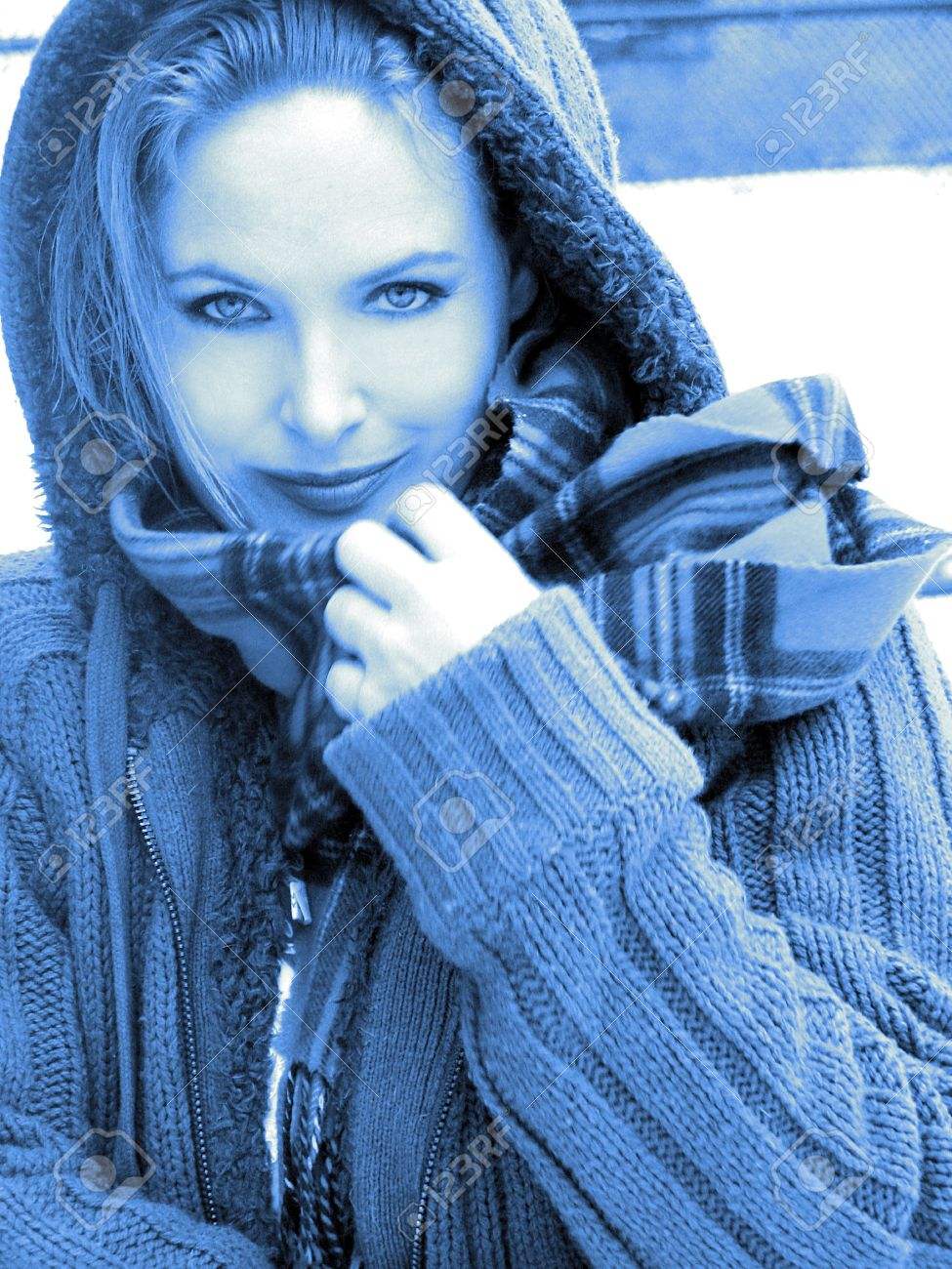 c3600142c9 Close-up of blonde girl smiling in sweater with scarf blue toned black and  white