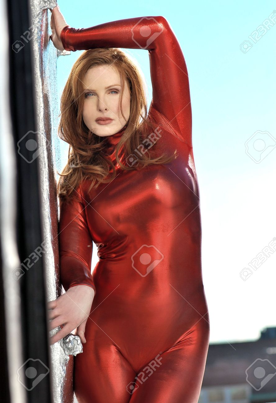 Sexy Redhead Plus Size Model In Red Metallic Jumpsuit Stock Photo 3772522
