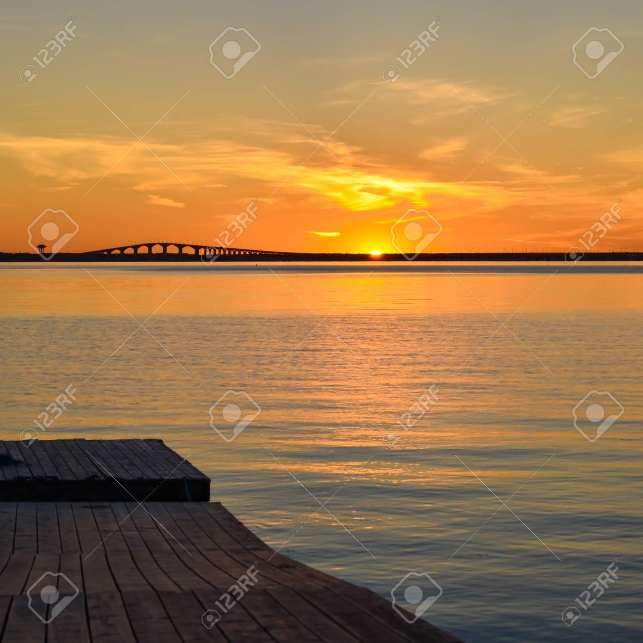 Sunset at the swedish Oland bridge in the Baltic sea Stock Photo - 21763932