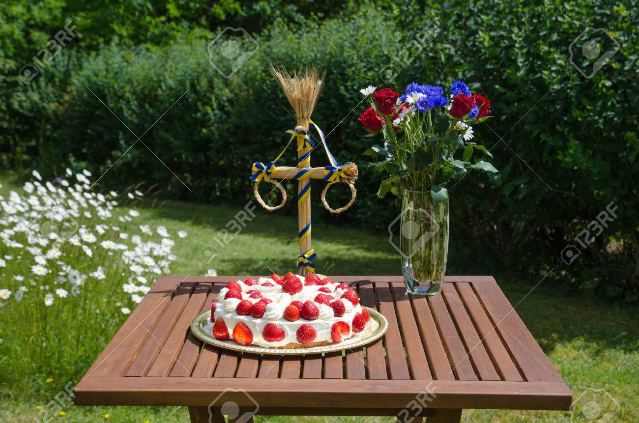 Homemade strawberry cake at a summer decorated table in a garden with daisies Stock Photo - 29651753
