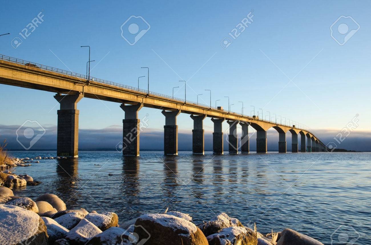 The Oland bridge in Sweden in the first winter morning sun. The bridge is one of the longest bridges in Europe and is connecting the island Oland with mainland Sweden. Stock Photo - 35391750
