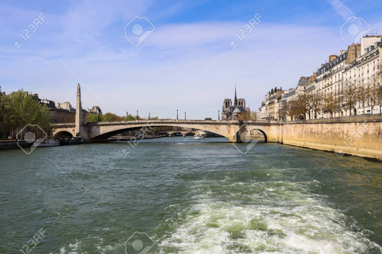 Bridge Pont De La Tournelle Across Seine River And Beautiful