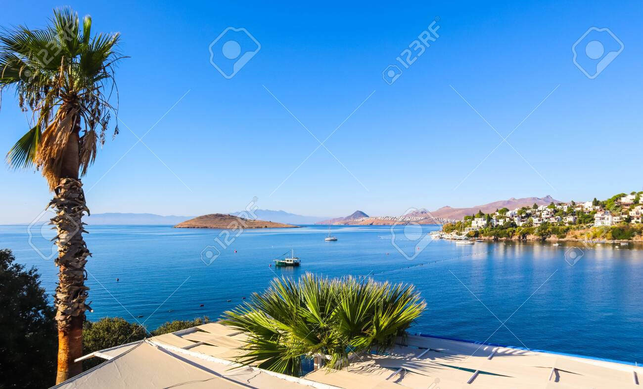Aegean coast with marvelous blue water, rich nature, islands, mountains and small white houses - 137528876