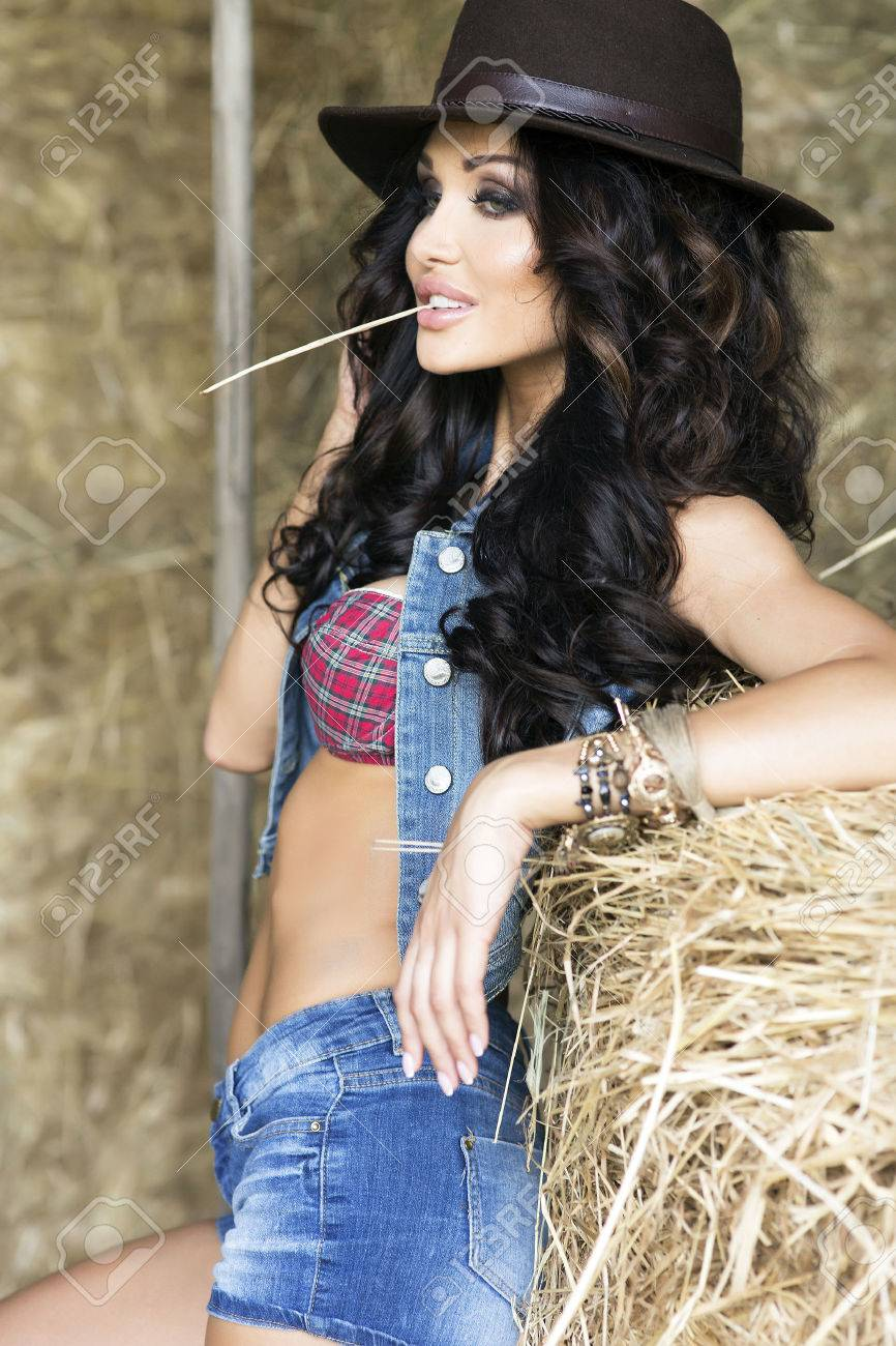 Stock Photo - Young sexy Woman wearing cowboy hat d2296802f966