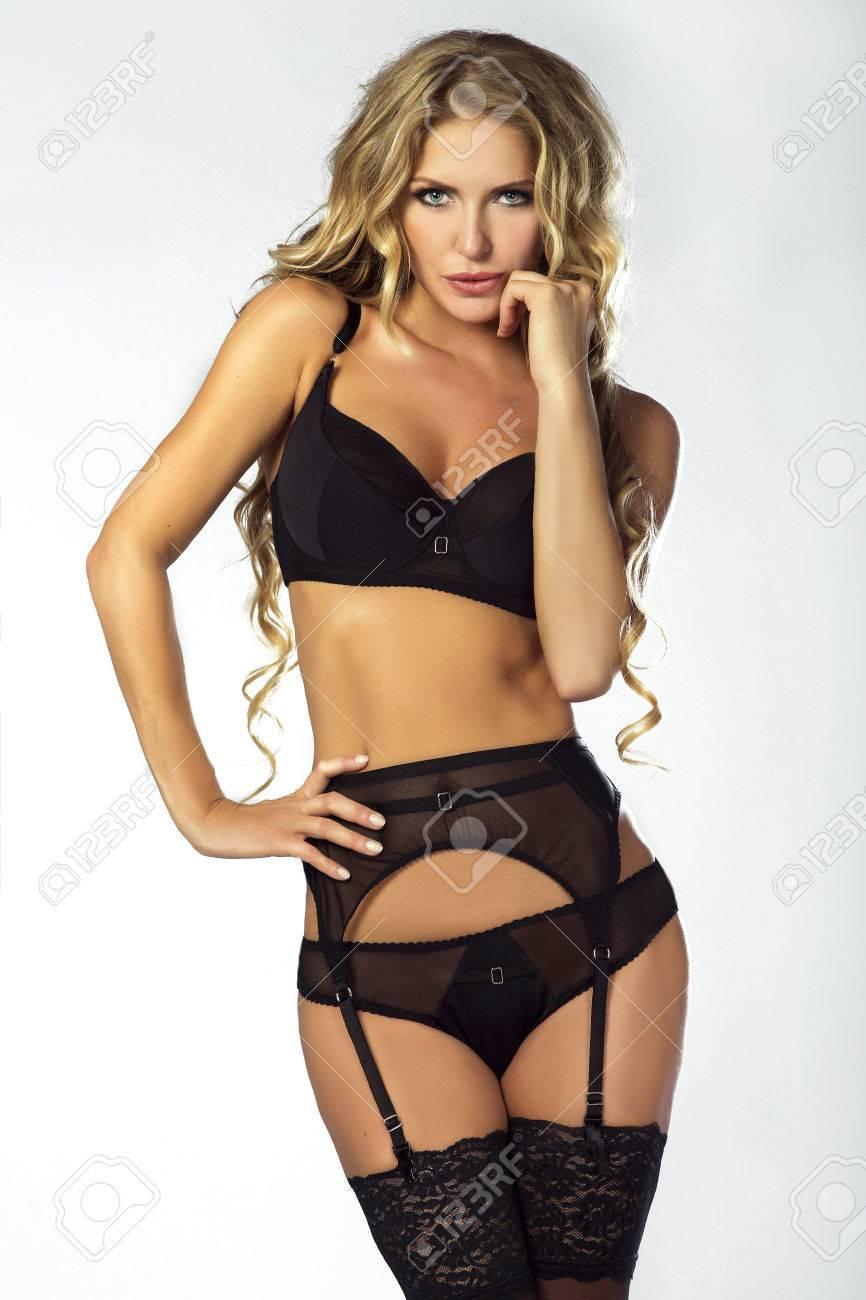 sexy blonde beautiful woman posing in studio, wearing sensual