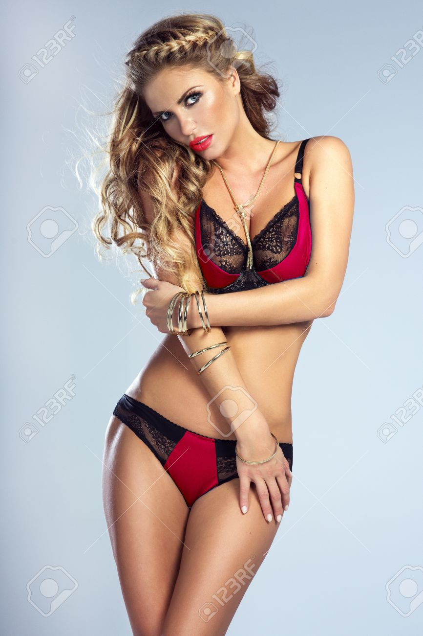 sexy blonde young woman posing in elegant lingerie, studio shot