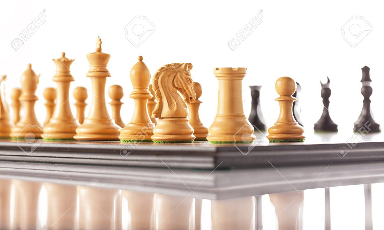 Chess pieces setup before the game - black and white chess pieces